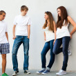 Group of young guys and girls in street — Stock Photo