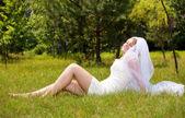 Happy girl in wedding dress — Stock Photo