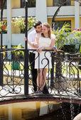 Newlywed couple in love stood on bridge — Stock Photo