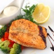 Salmon fried with spices - Stock Photo