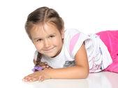 Little Girl on white floor — Stock Photo