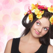Young brunette with flowers on head — Stock Photo