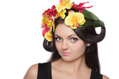 Pretty woman with flowers on head — Stock Photo