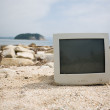 Old monitor on the beach. — Foto de Stock