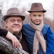 Stock Photo: Grandfather and grandson outdoors.