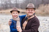 Joyful grandfather and grandson outdoors. — Stock Photo