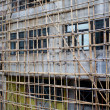 Royalty-Free Stock Photo: Bamboo scaffolding in front of the building.