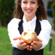 Businesswoman with moneybox - Stockfoto