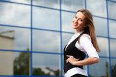 Businesswoman near office building — Stock Photo