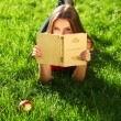 Woman in the park with book — Stock Photo #7339329