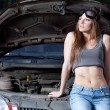 Woman repair car - Stock Photo