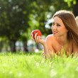 Woman in the park with book — Stock Photo