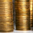 Golden and silver coin stacks — Stock Photo #7824340