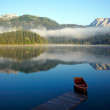 Landscape with mountains, lake and boat - Stockfoto