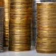 Golden and silver coin stacks - Stock Photo