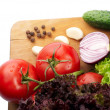 Fresh vegetables on wooden hardboard — Stock Photo