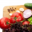 Fresh vegetables on wooden hardboard — Stock Photo #7824624