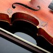 Violin and bow on dark background - Stok fotoğraf