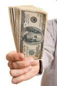 Businessman holding dollars stack — Stock Photo