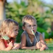 Two children with lollipops — Stock Photo