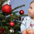 Little baby and Christmas tree — Stock Photo