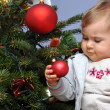Little baby and Christmas tree — Stock Photo #7308324