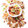 Nuts and dried fruit isolated on white — Stock Photo