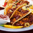 Chili con carne burrito in taco shell — Stock Photo