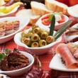 Pickled olives with other antipasto food — Stockfoto