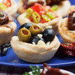 Olives in bred cup, appetizer series — Foto de stock #7362385