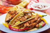 Taco shells filled with chicken meat — Stock Photo