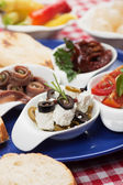 Cheese and olives appetizer — Stock Photo