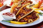 Chili con carne burrito in taco shell — Stock Photo