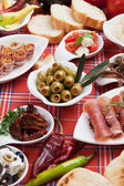 Pickled olives with other antipasto food — Stock Photo