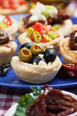 Olives in bred cup, appetizer series — Stock Photo