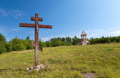 Cross in honor of the basis of church and under construction orthodox churc — Stock Photo