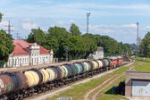 Railway station and cargo train. Narva. Estonia. — Stock Photo