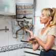 The young woman is upset by that the gas water heater has broken - Stock Photo