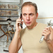 The man calls by phone to cause the repairman of gas water heaters — Stock Photo