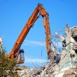 Stock Photo: Dredge destroys old building