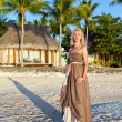 Young womin long sundress on tropical beach. Polynesia. Island T — Foto de stock #7025592