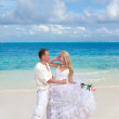The groom and the bride on the tropical beach — Stock Photo #7025595
