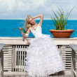 The bride on a wooden platform over the sea — Stock Photo #7025619