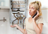 The young woman the housewife calls in a workshop on repair of gas water — Stock Photo