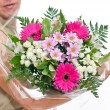 Brawny man's hand with a bouquet of flowers — Stock Photo