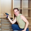 The man establishes baskets in a new wardrobe — Stock Photo #7252270