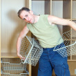 The man establishes baskets in a new wardrobe - Photo