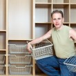The man establishes baskets in a new wardrobe — Stock Photo