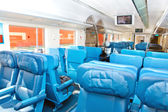 Interior of a passenger train with empty seats — Stock Photo