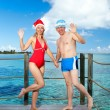 The man and the woman in New Year's suits on a beach. — Stock Photo #7598465